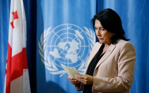 Georgian leader sees NATO future, seeks tough line on Russia